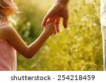 a parent holds the hand of a... | Shutterstock . vector #254218459
