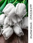fresh white tulips on a... | Shutterstock . vector #254226199