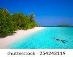 young man snorkeling in...   Shutterstock . vector #254243119