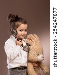 young girl with plosh toy calls ...   Shutterstock . vector #254247877