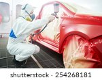 auto mechanic worker painting a ...