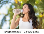pretty brunette drinking bottle ... | Shutterstock . vector #254291251