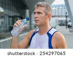 athletic man drinking water... | Shutterstock . vector #254297065