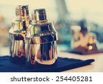 Small photo of Bartender tools on bar counter, toned image