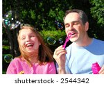 father and daughter blowing... | Shutterstock . vector #2544342