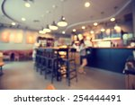 Stock photo blurred background made with vintage tones coffee shop blur background with bokeh 254444491
