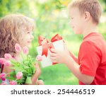 Happy Children With Bouquet Of...
