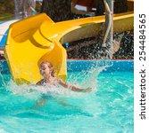 little girl on water slide at... | Shutterstock . vector #254484565