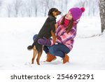 Stock photo young stylish woman with a dog having fun in a winter forest 254692291