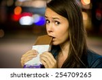 Young Woman Eating Chocolate I...