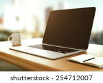 workspace with modern laptop at ... | Shutterstock . vector #254712007