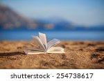 Open Book On A Beach