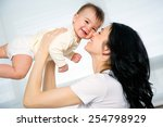 happy mother with adorable baby | Shutterstock . vector #254798929