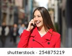 Cheerful Woman Talking On The...