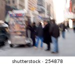 This is a blur shot of people waiting on line for the morning coffee wagon. - stock photo