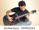 handsome man with guitar over... | Shutterstock . vector #254902261