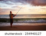Man Casting A Fishing Line Into ...