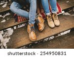 legs of two persons sitting on... | Shutterstock . vector #254950831