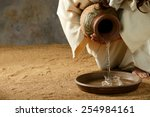 Jesus Pouring Water From A Jar...