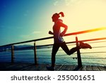 Stock photo healthy lifestyle sports woman running on wooden boardwalk sunrise seaside 255001651