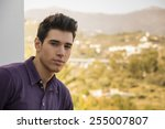 attractive young man standing... | Shutterstock . vector #255007807