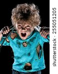 Boy has a electric shock over black background - stock photo