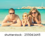 happy family on the beach... | Shutterstock . vector #255061645