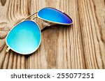 blue mirrored sunglasses on the ... | Shutterstock . vector #255077251