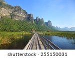 Wooden Bridge And Lake In Sam...