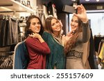 three women taking a selfie... | Shutterstock . vector #255157609