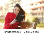 Woman Reading An Ebook Or...