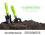 Garden Tools In Soil Isolated...