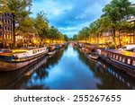 Stock photo canals of amsterdam at night amsterdam is the capital and most populous city of the netherlands 255267655