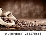 Old Desk Of Coffee Beans And...
