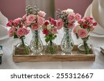 five bouquets of roses on a... | Shutterstock . vector #255312667