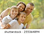 happy family in summer park | Shutterstock . vector #255364894