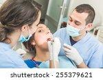 dentist and dental assistant... | Shutterstock . vector #255379621