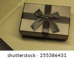 gold box with gifts and brown... | Shutterstock . vector #255386431