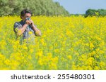 man in field blowing his nose... | Shutterstock . vector #255480301