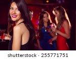 pretty brunette drinking a... | Shutterstock . vector #255771751