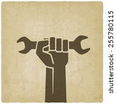 worker hand with wrench symbol...