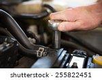 mechanic working on an engine... | Shutterstock . vector #255822451