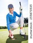 Smiling Lady Golfer Kneeling O...