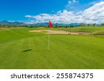red flag and sand bunkers at... | Shutterstock . vector #255874375
