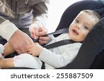 parents securing baby in the... | Shutterstock . vector #255887509