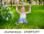 happy child playing in a spring ...   Shutterstock . vector #255895297