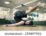 fit man doing pilates in... | Shutterstock . vector #255897931