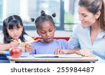 happy beautiful female teacher... | Shutterstock . vector #255984487
