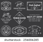 white on black seafood labels... | Shutterstock .eps vector #256006285
