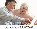 happy mature couple using... | Shutterstock . vector #256007461